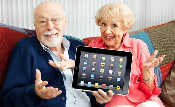 Seniors holding tablet
